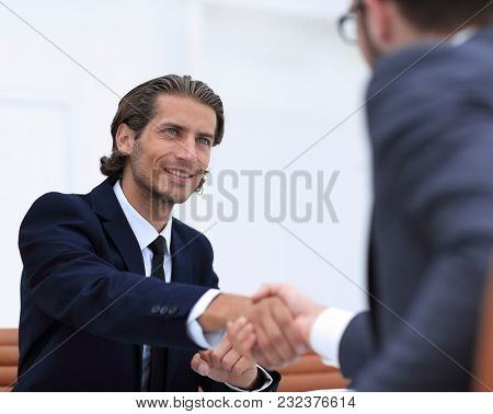 handshake Manager and the client sitting in the office