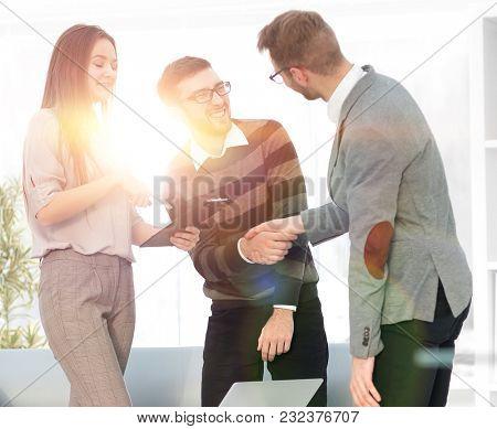 friendly handshake between colleagues