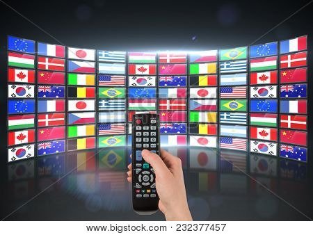 Digital composite of panel with flags (bigger one) hand with remote
