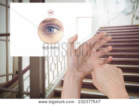 Digital composite of Hand Touching Glass Screen and Identity eye Verify App Interface on stairs