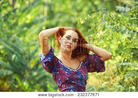Beautiful Young Woman Resting In Summer Park , Enjoying Nature Outdoors. Happy Girl Breathing Fresh
