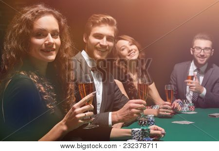 beautiful woman sitting at a table in a casino