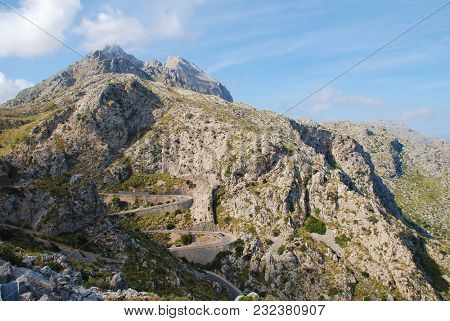 MAJORCA, SPAIN - SEPTEMBER 6, 2017: The twisting road down to Sa Calobra in the Serra de Tramuntana mountains on the Spanish island of Majorca. Built in 1932, the 9.4km route is popular with cyclists.