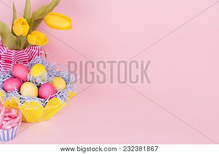 Bright Colorful Easter Background With Painted Eggs, Tulips, Cupcake On Soft Light Backdrop, Closeup
