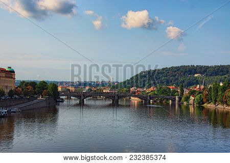 A Picturesque View To The Manes Bridge, Charles Bridge And The Vltava River From The Svatopluk Cech