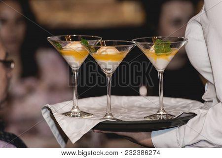 Waiter Serving Ice Cream Desert In A Glass