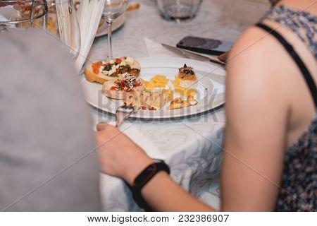 Woman Eats Snacks With Pasta, Cheese, Vegetables. Spain Tapas Recipe Food Pintxos. Served Dish For F