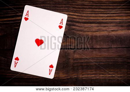 Playing Cards On An Old Wood Table