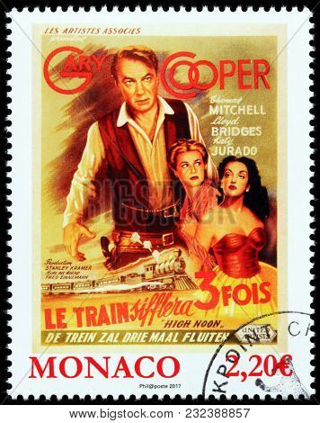 Luga, Russia - March 17, 2018: A Stamp Printed By Monaco Shows Famous Gary Cooper, Grace Kelly And K