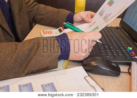 Pen On Paperwork Accounts With Man Use Computer To Save Data In Background. Man Hand With Pen, Calcu