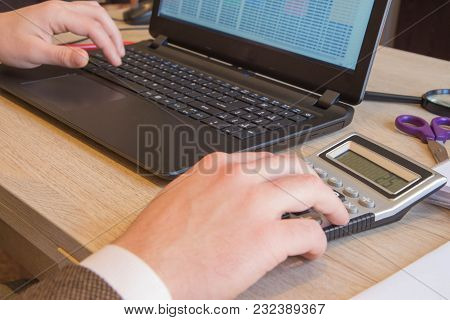 Hand With Calculator. Finance And Accounting Business. Young Businessman Calculating Finance Bills I