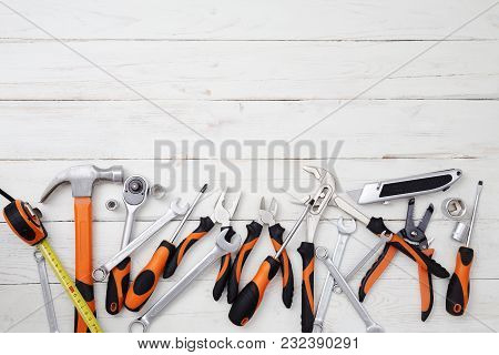 Construction Tools On The White Wooden Background.