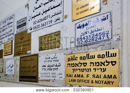 JERUSALEM, ISRAEL - DECEMBER 29, 2016:  Board with advertising signs in the entrance of the house in the Muslim quarter of Jerusalem. Israel