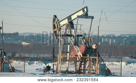 Operating Unit For Crude Oil Production Against The Background Of The City, Petroleum Industry