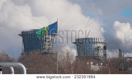 Nizhnekamsk, Russia - March, 2018: Pipes Of Large Chemical And Power Plant With Emissions, Flag Of T