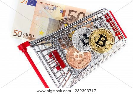 Financial Concept With Image Of Bitcoins In Shopping Cart On Fifty Euro Banknote. Traditional Money