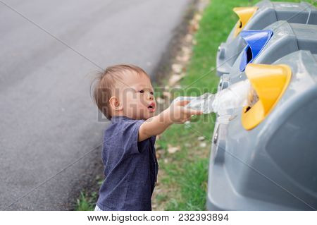 Cute Little Asian 18 Months / 1 Year Old Toddler Baby Boy Child Throwing Plastic Bottle In Recycling