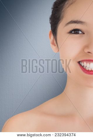 Digital composite of Close up of half woman's face against navy background