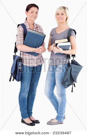 Portrait of College students holding books in a studio