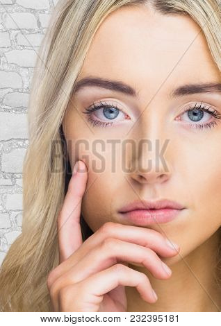 Digital composite of Close up of woman thinking against white brick wall