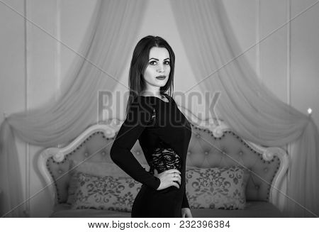 Black And White Portrait Of Beautiful Young Brunette Woman With Long Hair, Wearing Elegant Black Dre