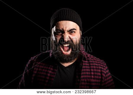 Bearded Man Screaming In Anger On Black Background In Studio Photo