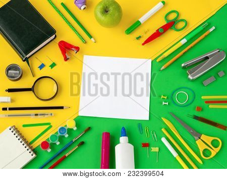 School Supplies On Green And Yellow Background Top View, Space For Text. Flat Lay