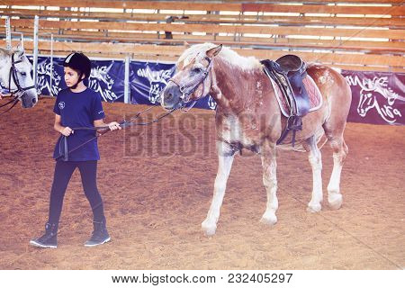 Ber Yakov, Israel - September 21, 2016: Horse Riding Lessons For Kids. The Near The Horse
