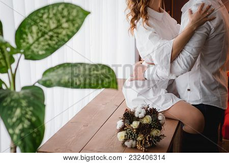 Wedding Couple On The Table And A Bouquet Of The Bride Rustic. Wedding In The Style Of Boho. Wedding