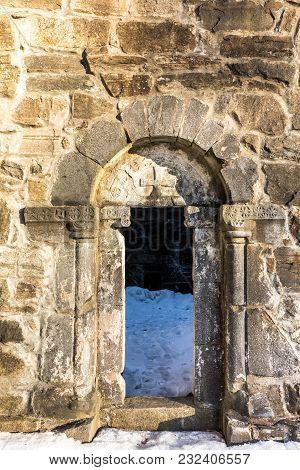 Old Door In The Ruins Of St. Olav's Church In Bamble, Norway.