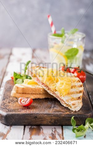 Hot Fresh Hawaii Toast Sandwich With Ham, Pineapple, Tomato And Cheese On Wooden Board. Healthy Summ
