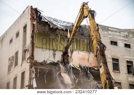 Deconstruction Of An Old Building By Hydraulic Crasher