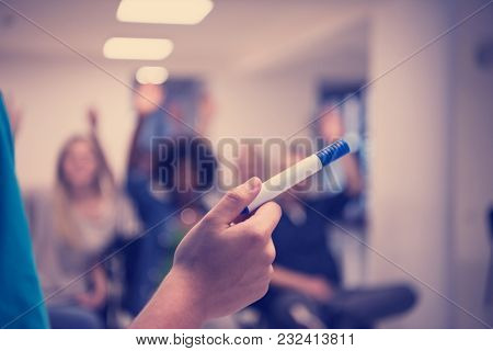 close up of teacher hand with marker while teaching lessons in school classroom to multiethnic students