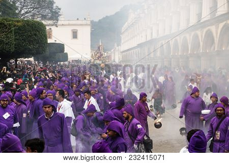 Antigua, Guatemala: March 18 2018: Purple Robed Men And Incense Smoker With Fire At The Procession S