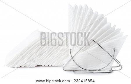 A Table Napkin Holder With White Napkins Isolated On White Background.