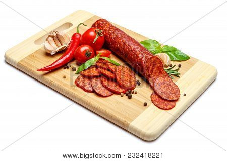Italian Salami Or Spanish Chorizo On Wooden Cutting Board. White Background