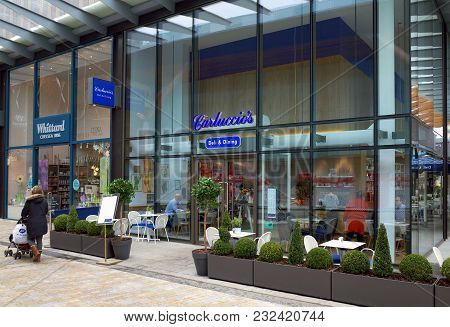 Bracknell, England - March 20, A Woman With A Pram Passes By Carluccios Deli & Dining In Bracknell,