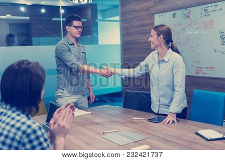 start up business people  handshake on team meeting  at modern business office interior