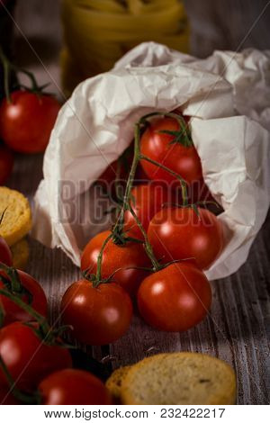 Small Cherry Tomatoes In Paper Bag With Bruschetta