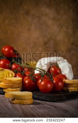 Small Cherry Tomatoes On Several Twigs With Bruschetta