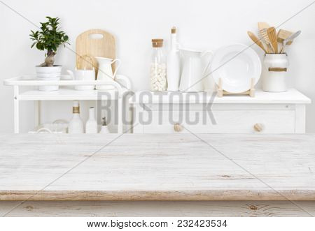 Bleached Tabletop With Copyspace Over Blurred Kitchen Furniture With Tools