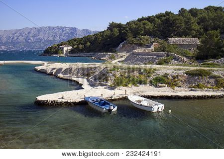Little Bay With Two Boats And Stone Houses In Povlja On Brac Island In Croatia