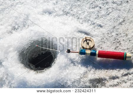 The Rod For Winter Fishing Lies Near A Hole