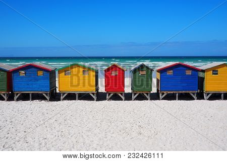 Row Of Colored Beach Huts On The Beach