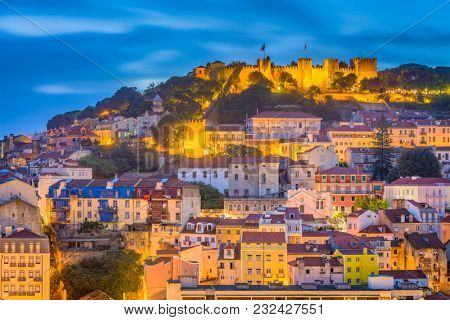 Lisbon, Portugal City Skyline with Sao Jorge Castle and Tagus River.