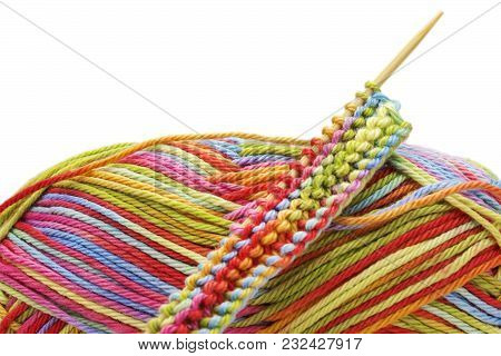 Knitting Colorful Melange Rainbow Cotton Ball And Knitting Needles Isolated On White Background. The