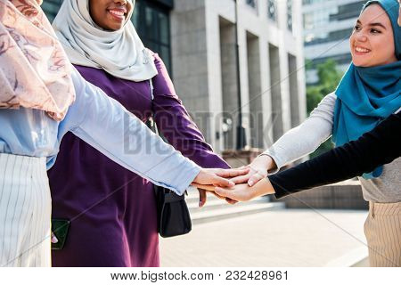 Islamic women hands slack teamwork