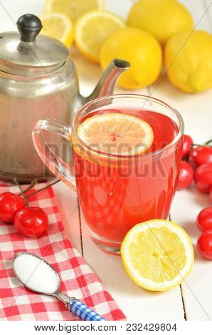 Fruit Cherry Tea With Slice Of Lemon In Glass Mug, Old Teapot, Red Checkered Tablecloth, Teaspoon Su