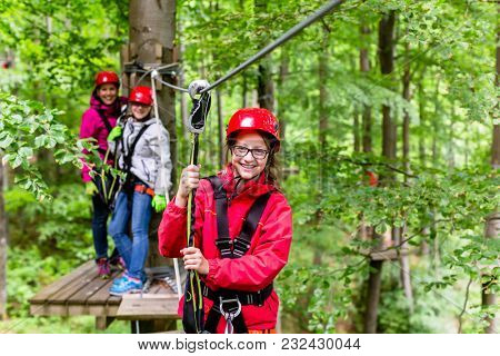 Family climbing in high rope course outdoors