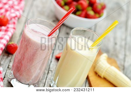 Strawberry And Banana Milkshake Smoothie Cocktail In The Glass With Straw, Fresh Strawberries, Banan